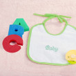 Baby bib with A B C letters — Stock Photo #9145535
