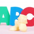 Baby boots with A B C letters — Stock Photo #9145548