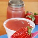 Closeup organic strawberry baby food concept — Stock Photo