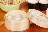 Asian dumpling in bamboo basket — Stock Photo