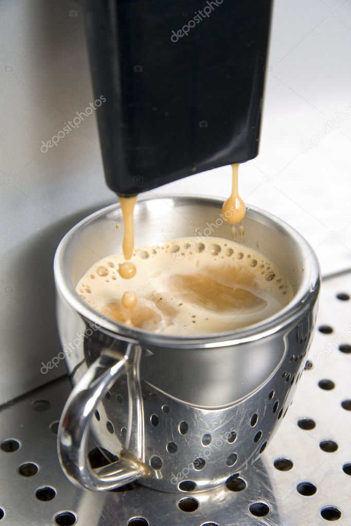 Espresso machine dispensing coffee into a stainless steel cup — Stock Photo #8607296