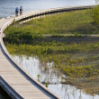 Stock Photo: Bicycling on boardwalk