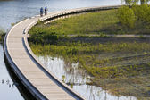 Bicycling on boardwalk — Stock Photo