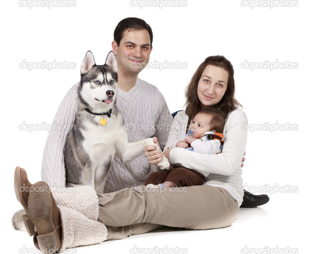 Portrait of a young family and their pet dog on white background — Stock Photo #9331844