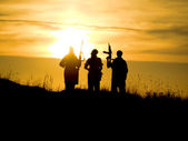 Soldiers against a sunset — Стоковое фото