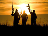 Soldiers against a sunset — Stock Photo