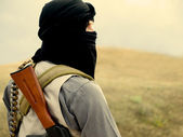 Muslim militant with rifle — Stock Photo