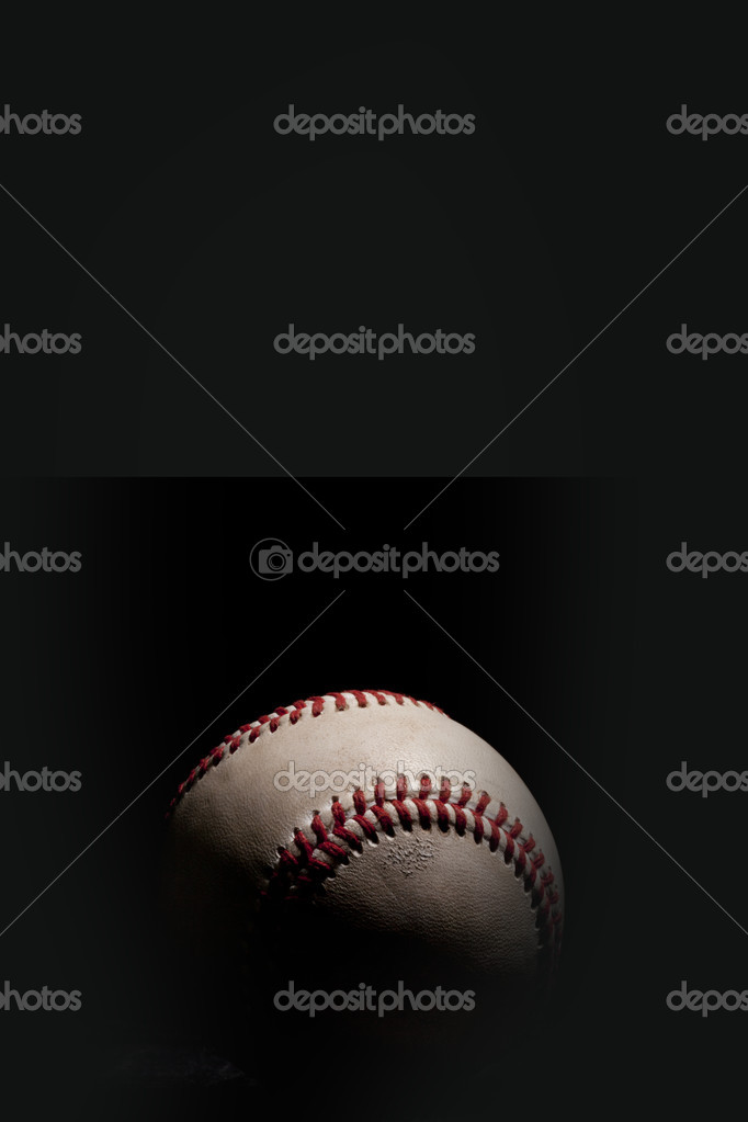 Baseball isolated on black background with dramatic lighting. Vertical orientation. — Stock Photo #9152428