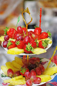 Fruits on three tier vase — Stock Photo