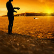 Man  standing  at bright sunset background — Stok fotoğraf