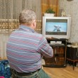 A man watching  screen of his television. — Стоковая фотография