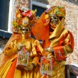 Royalty-Free Stock Photo: VENICE, ITALY - MARCH 5: Unidentified masked persons stand on sm