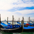 Gondolas on the Venice lagoon - Stock Photo