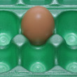 Stock Photo: Egg in green carton