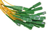Bundle of fiber optic cable with green plugs SC — Stock Photo