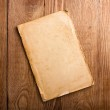 Old papers on a wooden table — Stock Photo