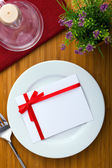 Plate with card — Stockfoto