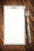Menu and fork — Stock Photo