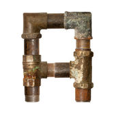 Alphabet of old pipes — Stock Photo