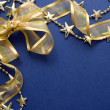 Stock Photo: Gold bow and ribbon on the card