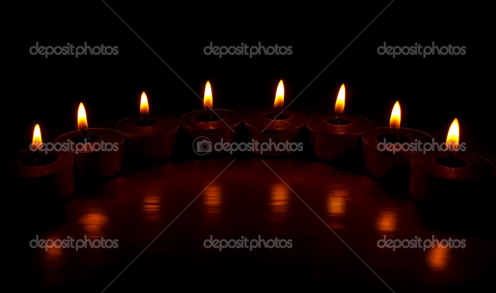 On a photo of a candle in a line. A night photo — Stock Photo #8136795