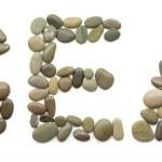 Alphabet of ocean stones — Stock Photo