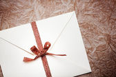 Envelope with a bow — Stock Photo