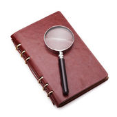 Notebook with a magnifier — Stock Photo