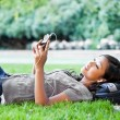 Asian college student listening to music — Stock Photo