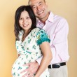 Royalty-Free Stock Photo: Pregnant Asian woman and her husband