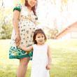 Pregnant Asian mother and her daughter — Stock Photo #8806971