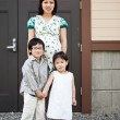 Pregnant Asian mother and her kids — Stock Photo