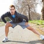 Mixed race man stretching — Stock Photo