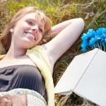 Beautiful Caucasian woman relaxing outdoor — Stock Photo #8807636