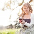 Beautiful woman texting on her phone outdoor — Stock Photo