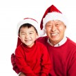 Asian grandfather celebrating Christmas with grandson — Stock Photo #8807807