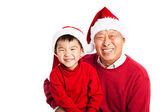 Asian grandfather celebrating Christmas with grandson — Stock Photo