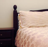 A bed in a luxurious bed room — Foto Stock