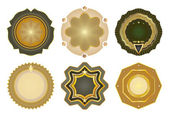 Set of vector gold-framed labels. — Stock Vector