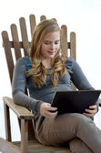 Blonde girl a tablet — Stock Photo