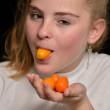 Girl with fruit orange Chinese — Stock Photo