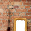 Photo frame and clay bottle with willow catkins — Stock Photo #10373371