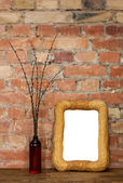 Photo frame and clay bottle with willow catkins — Stock Photo