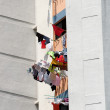 Laundry drying from windows, Singapore — Stock Photo #8595100