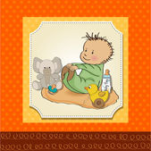 Little baby boy play with his toy baby shower card — Stock Photo