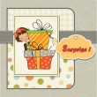 Cute little girl hidden behind boxes of gifts. happy birthday greeting card — Stock Photo
