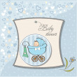 Baby boy announcement card with baby and pram - Стоковая фотография