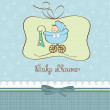 Baby boy announcement card with baby and pram — Stock Photo #9044323
