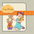 Litlittle girl playing with her birthday gifts . happy birthday card — Stock Photo