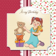 Stock Photo: Litlittle girl playing with her birthday gifts . happy birthday card